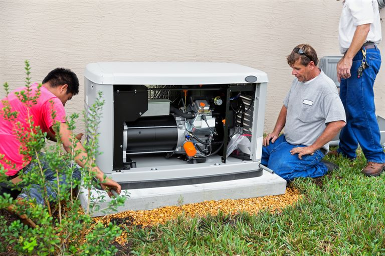 3 peoply figuring out how to connect a generator to their home