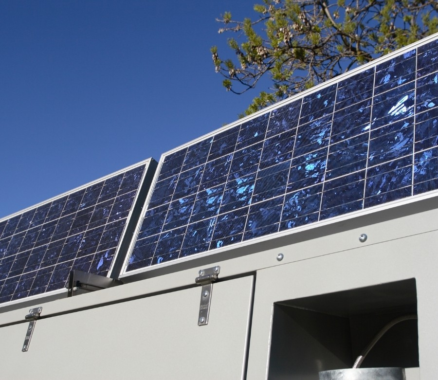 Two solar panels in an upright position on the roof of an RV.